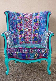 Makes me think of putting the Ecuadorian fabric on the cat's chair. love.love.love.