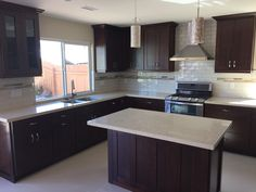 After remodeled kitchen project. Opened up space, bright natural light, with clean simple colors. Beautiful & updated kitchen