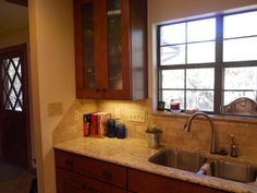 granite counter, subway tile, delta faucet  with touch turn on