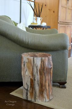 One of the easiest DIY's ever! See our Wood Stump Side Table at http://www.anoregoncottage.com/wood-stump-side-table/ #decorating #easydecor
