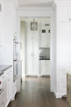California Beach House Design - Butler's Pantry: Having a butler's pantry off the kitchen is always a smart idea. Floor-to-ceiling cabinets add extra storage space.