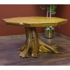 Rustic Cedar Log From the Shire Stump Octagon Dining Table is shown with a Light Honey Finish and can fit up to 8 people.- Rustic dining