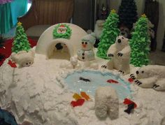 """Butter cream icing on the iceberg. Igloo, polar bears, snowballs and Eskimo all made out of fondant. Trees are ice cream cones with butter cream leaves.  """"Ice hole""""  is clear piping gel over blue colored icing. Gummy fish on sides."""