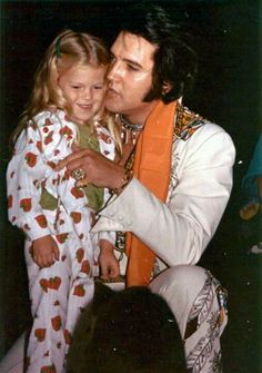 What a lucky little girl. I wonder if she remembers this and what he says to her? Would love to know what she's doing now (This was listed as Elvis and Lisa but obviously it isn't Lisa)
