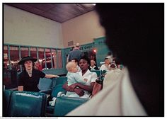The vivid color images focused on the extended family of Mr and Mrs Albert Thornton who lived in Mobile, Alabama during segregation in the Southern states. In another photograph, taken inside an airline terminal in Atlanta, Georgia, an African American maid can be seen clutching onto a young baby, as a white woman watches on - a single seat with a teddy bear on it dividing them. Many white families hired black maids to care for their children, clean their homes, and cook their food.