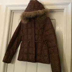 SALE🎉GORGEOUS Winter or Ski Nylon Coat w/Fur Trim SALE🎉GORGEOUS Winter or Ski Nylon Coat w/ detachable Hood w/ Authentic Fur trimmed  hood. Fur trim snaps off, hood snaps off or on. 2 side pockets to keep your hands warm. Front hidden zipper w/ signature Gold Baby Phat Charm. Warm ribbed cuffs inside on arm ends. Drawstring cinched waist w/ front cord pulls w/ gold locks. 60% Down filling, 40% feather filling, 100% nylon shell, 100% poly signature lining. (120)🎁🅿️🅿️ Trade Baby Phat…
