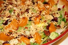 Anything and Everything Salad - a mixture of lettuces and various toppings, here topped with broccoli, bacon, mandarin oranges, dried cranberries, dressed with a sweet and sour dressing and topped with a buttery almond, pecan and ramen noodle crunch.