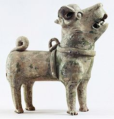 China 1st century  The dog had the task of guarding the tomb and driving away evil influences.