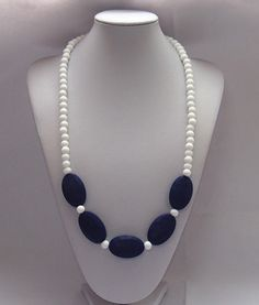Navy Bue silicone teething necklace for mom to wear and baby to enjoy.