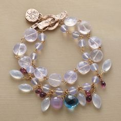 LAVENDER QUARTZ GARDEN BRACELET -- Jes MaHarry offers a glimpse of her garden, sprinkling two strands of lilac quartz with amethyst briolettes, chalcedony and a showstopper London blue topaz. Exclusive. Handmade in USA with14kt rose gold toggle_ok
