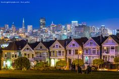 Here's the Painted Ladies, AKA 'Full House Houses' with SF and the Bay Bridge Lights in the background.  Photo Credit: Traveling Photographs : Dave Gordon