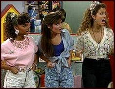 "Kelly Kapowski    Kelly had the classic ""saved by the bell"" charm in how she dressed.    This style was the ""sweet girl next door"" fashion of cropped shirts and overalls. This fashion also lead to the exposed midriff and the navel ring."