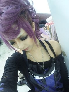 purple hair rokku gyaru.  Reminds me of Payne from FFX-2 even though she has silver hair