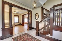 Gorgeous entryway with open staircase from a 1910 home I recently sold in North Minneapolis. Open Staircase, Stairs, Wall Molding, Moldings, 2 Story Houses, Stained Glass Windows, Victorian Era, Built Ins, My House