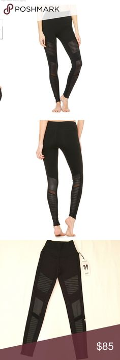 ALO YOGA HIGH WAIST MOTO LEGGING BLACK NWT XXS Our power-player, the patented Moto Legging gets a fresh update with this limited edition, color-blocking update. The quilted stitching with mixed matte shine fabric and mesh details that pop in contrasting colors and even more street cred.  - Engineered to lift, sculpt, contour and smooth - Wear-tested by our in-house team for the perfect fit - Hidden key pocket - 4-way-stretch fabric for a move-with-you feel - Moisture-wicking antimicrobial…