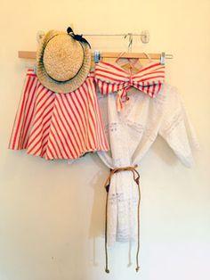 Itsy bitsy, teeny weeny, red and white, striped bikini.