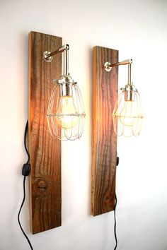 Reclaimed Wood Lamps // Pair of Wall Sconces @flea_pop 'Mesic' wall sconce. Reclaimed barn wood is paired with industrial style cage lighting to create a rustic, ready-to-hang wall sconce. The perfect touch of rustic warmth for any home or workplace. • Listing is for one pair of sconces.