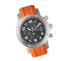 Clipper Chrono Mécanique Plongée:  Hermès swiss-made watch, mechanical self winding chronograph    Titanium and Steel case with dark grey 44 mm dial, orange rubber bracelet.