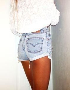 High wasted, faded blue jean shorts.
