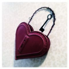 Big red heart secured / locked for its own protection / does that key still work?