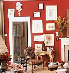 Interesting placement of art on red wall