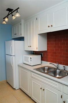 Kitchen in Deluxe One Bedroom Suite