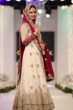 Pakistani Bridal Dress! Beautiful. My sister had this design but a red top and cream lehnga. Looked Amazing!