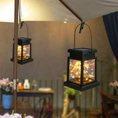 """Creates a warm wonderful feeling in your yard! These solar lanterns can either sit flat or be hung where you see fit. Made from a polymer blend, so they won't rust, will last a long time and handle the weather. Work well on patios, porches, pergolas, gazebos, decks and more! • Includes: Hanger, Lantern, Solar Panel and Lights • 3.5"""" x 3.5"""" x 5"""" • IP65 Rated Waterproof • 6 Hours Charge Time • 8 Hours of Light Solar Lanterns, Traditional Lighting, 8 Hours, Solar Panels, Porches, Decks, Gazebo, Rust, Hanger"""