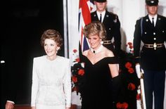 Diana, Princess of Wales standing outside the White House with First Lady Nancy Reagan on November 9, 1985. Diana wore her iconic midnight blue Victor Edelstein velvet off the shoulder evening gown in which she was famously captured dancing with John Travolta that night. She is also wearing a large sapphire brooch given to her by the Queen Mother as a wedding present which earlier that year she had set as the centerpiece of the pearl choker she wears. Fashion Icon. Iconic Fashion.