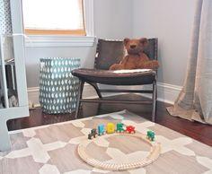 Fletcher's Nursery: Madeline Weinrib geometric area rug and Celadon cowhide chair Nursery Storage, Nursery Organization, Cowhide Chair, Little Green Notebook, Nursery Inspiration, Nursery Ideas, Design Inspiration, Room Tour, Nursery Design