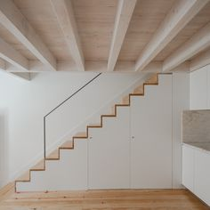 PF architecture studio turns block into modern casas da baixa Staircase Storage, Stair Storage, Stairs In Living Room, House Stairs, Garage Interior, Interior Stairs, Modern Staircase, Staircase Design, Casa Mix