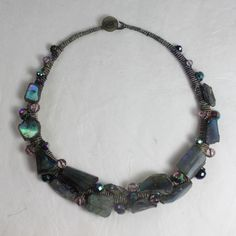 Amanda Caines creates unique hand stitched and bound fabric jewellery and icons using semi precious stones, wood, object d'art and tumbled glass.