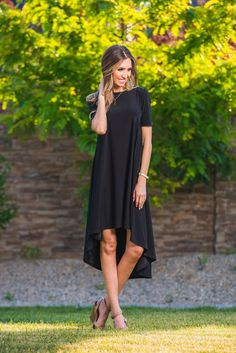 A beautiful and classic high low tee shirt dress featuring a slinky smooth venezia fabric and two pleats in back to create a greater flow! Great for day or night wear with heels or flats. Layer up wit