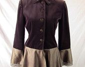 This upcycled coat began its life as a lovely plum-colored velvet blazer, and in its second life it has turned into this – a longer, stronger version of itself.  This coat has a lovely velvet bodice, onto which was added a very cool, slightly edgy metallic taupe and purple snakeprint fabric skirt, which gives it a nice flounce and flow.