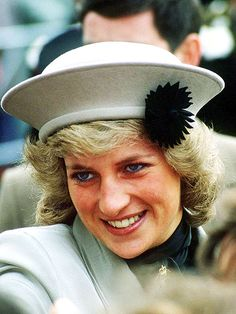 IN NEUTRALThe Princess added a flourish to her beige chapeau for an October 1987 walkabout outside Winchester Castle.