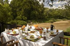 The Kuname River Lodge is extremely proud of its chef and cuisine served in an open boma or on the outdoor terrace. River Lodge, Terrace, Table Settings, Places, Cocktail, African, Outdoor, Coffee, Breakfast