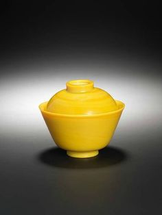 A Beijing yellow glass bowl and cover. Incised Qianlong four-character marks and probably of the period. photo Bonhams