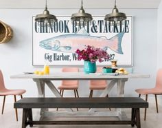 Large Nautical Bait and Tackle Art above Dining Table at HGTV Dream Home in Gig Harbor. Featured on Completely Coastal.