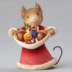Mouse with Acorn Ornaments is busy getting ready for decorating the village trees with seeds, acorns, fruit, and cheese for Christmas. All her mice friends will be there to help. They can wait for all