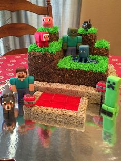 Minecraft- Figures are all fondant, buttercream with crushed oreos/graham crackers to represent dirt, poured red sugar tiles for lava, rice krispie (gray color doesn't really show in picture) to represent cobblestone, and homemade piping gel for water.