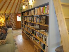 Awesome yurt with a raised platform/bookshelf/divider!  from maria4 by White Mountain Yurts, via Flickr