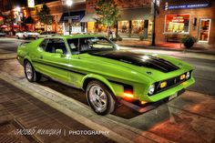 This is a high dynamic range photo of a green 1971 Ford Mustang.
