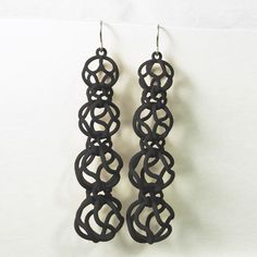 Twisted Sphere Earrings Black // 3D printed intricacy.Join the 3D Printing Conversation: http://www.fuelyourproductdesign.com/
