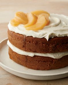Pumpkin Layer CakeThis spiced pumpkin cake is enhanced by layers of a delectably rich frosting that features cream cheese and goat cheese. Quince, available in the fall, has a fragrant, apple-like flavor. If you can't find fresh ones, use pears or apples instead.