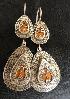 AGE:   1990'sITEM:  Very Fine Earrings purchased in Paris but crafted in        North Africa.  Beautiful detail in a tear drop shape, with a coral