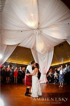 Gorgeous draping for this dance floor, topped off with a dramatic kiss at The Foundry at Oswego Pointe.