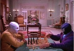 El Santo and the Blue Demon enjoying a game of chess.