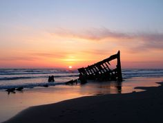 Taken at sunset in late spring, the wreck of the four-masted steel barque sailing ship Peter Iredale cuts a haunting yet beautiful form on the Oregon coast.