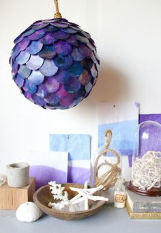 DIY Fish scale pendant lamp - A paper lantern, a circle cutter and Rit dye combine to create a funky pendant lamp.