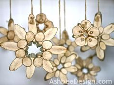 Marji at Ashbee Design created starburst flowers from branch wood slices.